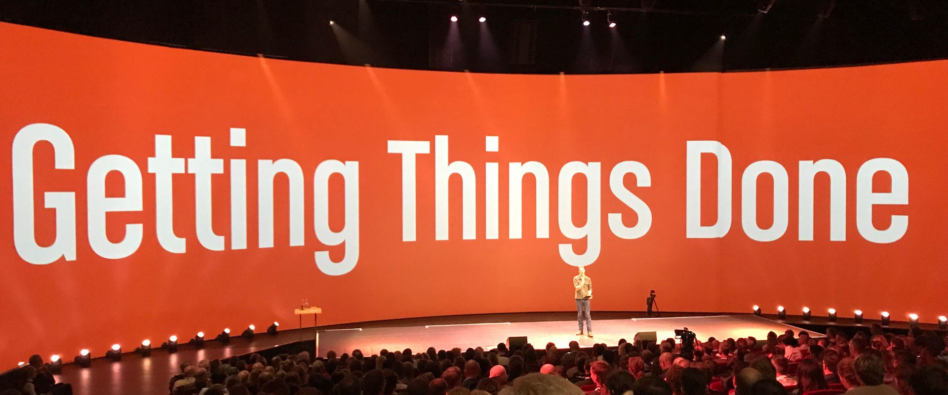 "Stage with ""Getting Things Done"" printed on the main screen"