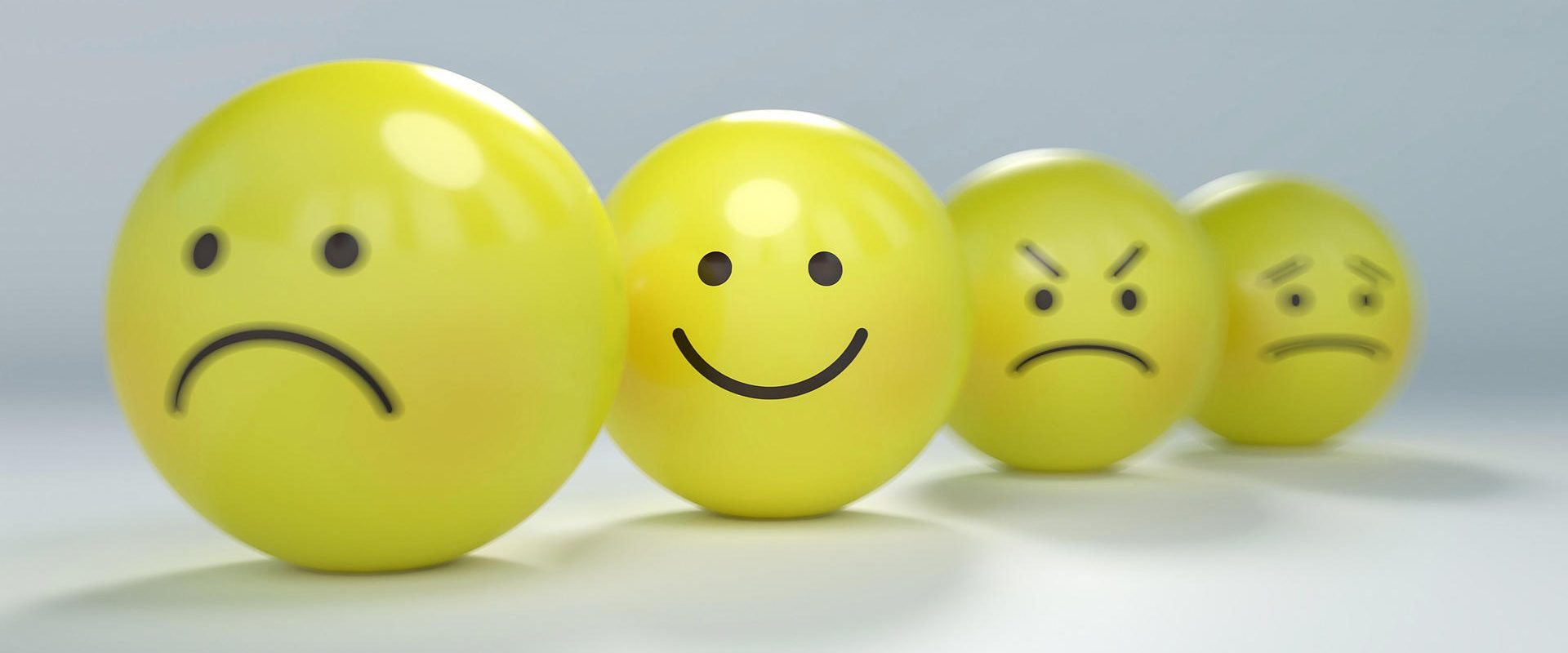 Yellow balls with different facial expression